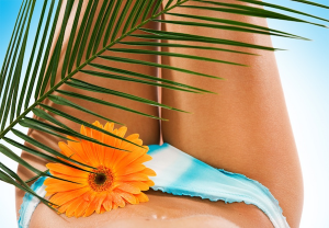 9 Natural Tanning Oils (& Sun Protective Tan Accelerator Recipe) To Protect Skin & Enhance Your Tan